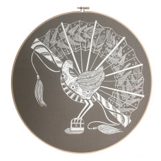 Screen printed lyrebird framed in embroidery hoop in chocolate