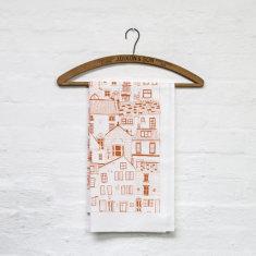 Jessica Hogarth coastal cottages tea towel in orange