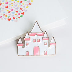 Castle pin brooch