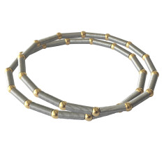 Satellite bracelet with gold beads