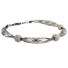 Sterling silver knitted bracelet with diamond cut balls