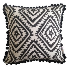 Black jagged diamond linen cushion with pom poms