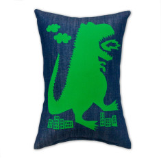 Fire breathing dinosaur cushion on denim