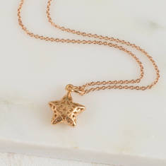 Matte rose gold filigree star necklace