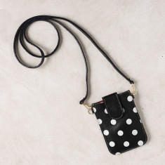 Mobile phone pouch in black polka dots