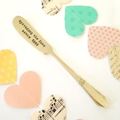 Hand-stamped vintage spreading the love butter spreader