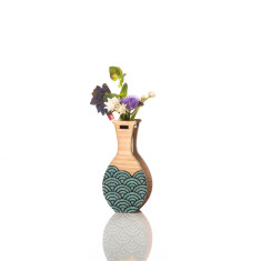 Small handmade vase in teal wave