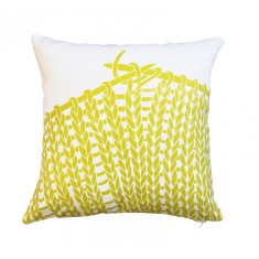Knitting cushion cover in chartreuse on white