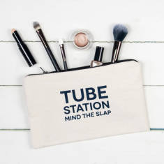 Tube station mind the slap make up pouch