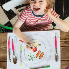 kid's placemat in a carry bag with doodle pens