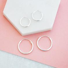 Minimalist huggie earrings in sterling silver