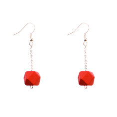Drop earrings with red faceted wooden beads by Mon Bijou