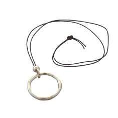 Silver circle necklace on leather