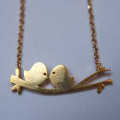 Love birds on a branch pendant necklace in gold
