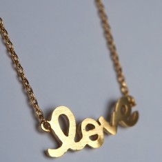Love letter pendant necklace in gold