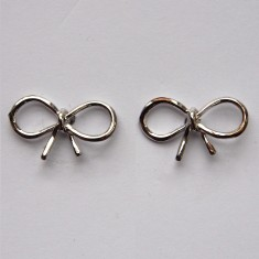 Tiny bow stud earrings in silver