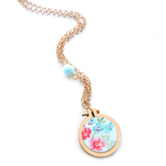 Embroidery hoop necklace in blue