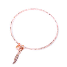 Diamond cut rose gold stacking bangle with tiny feather charm and tag
