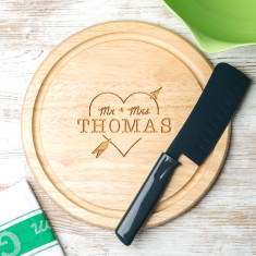 Personalised heart and arrow round chopping board