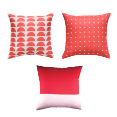 Set of three red cushion covers