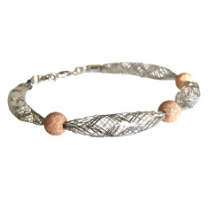 Sterling silver knitted bracelet with rose diamond cut balls