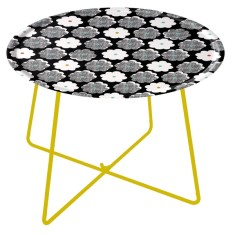 Wooden tray table in black with grey and white flowers with yellow metal feet