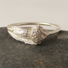 Silver daisy head and petal ring
