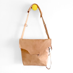 Shoulder bag with raw edges