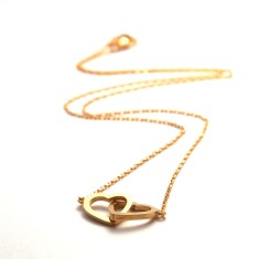 Two hearts necklace in gold