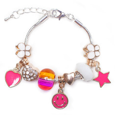 Pink and gold charm bracelet