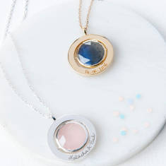 Personalised gem spinning necklace