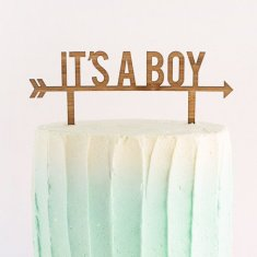 It's a boy cake topper in wood