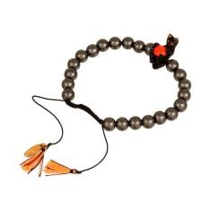 Black cat playing bracelet