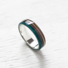 Wooden ring with silver band inside