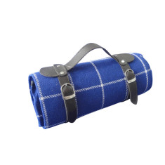 Picnic blanket in blue with waterproof backing and straps