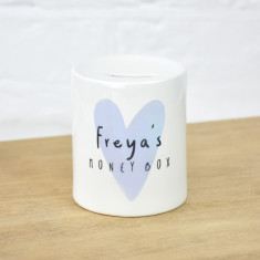 Personalised child's money box with blue heart