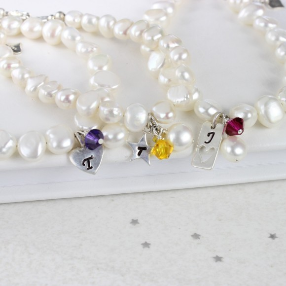 personalised pearl bracelet with purple, yellow and fuchsia pink crystals