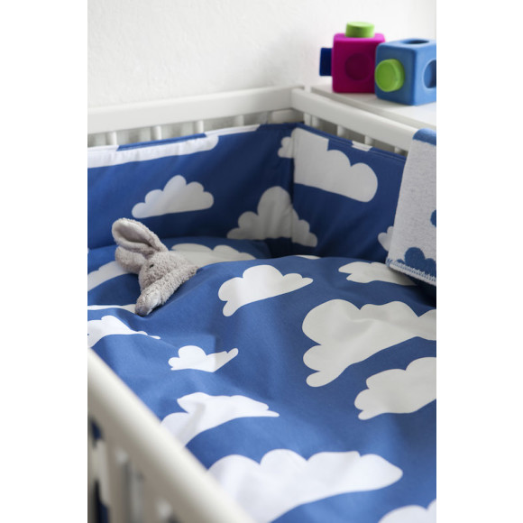 Blue in a cot