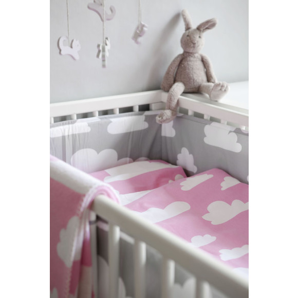 Pink in a cot