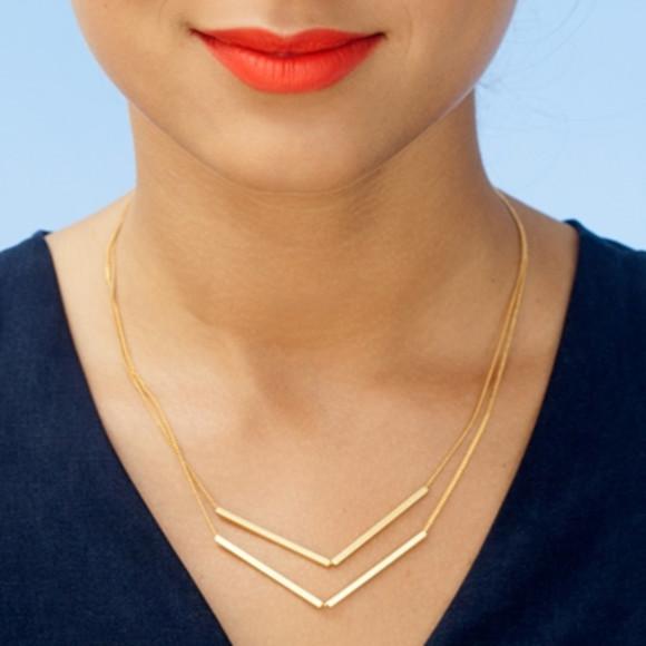 Model wearing gold skipper necklace