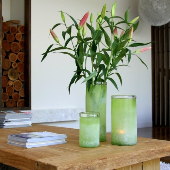 green vases on a coffee table
