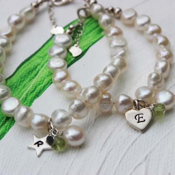 childs freshwater pearl christening bracelet with peridot birthstone for august birthdays