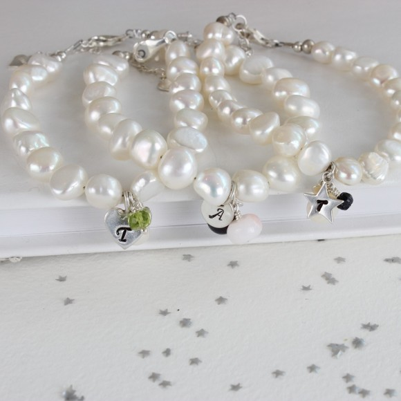 white baroque pearl bracelet with heart charm and peridot (August), disc charn with pink opal (October) and star charm with Sapphire (September)