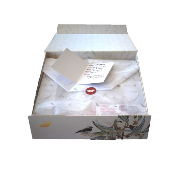 Our git hamper wrapped in bespoke tissue featuring gum leaves, beetles and butterflies