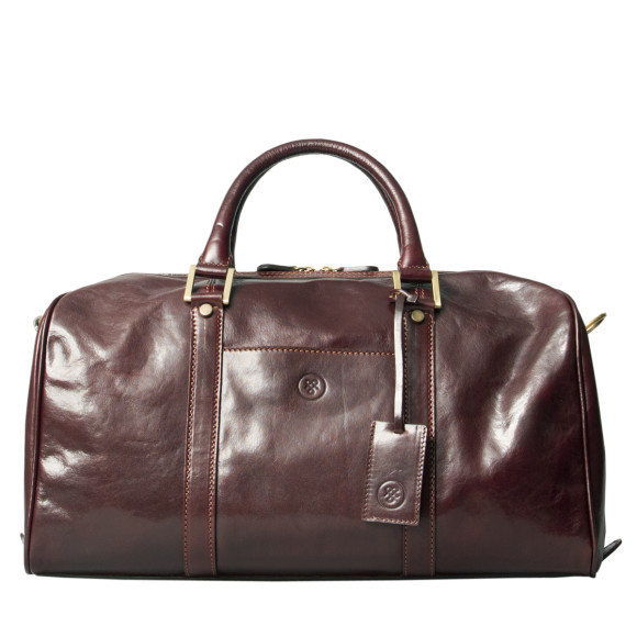 Small leather luggage bag in brown