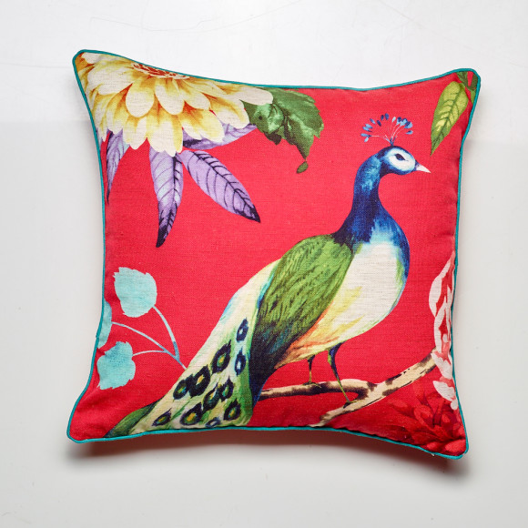 Peacock cushion in red, comes with a teal coloured piping edge