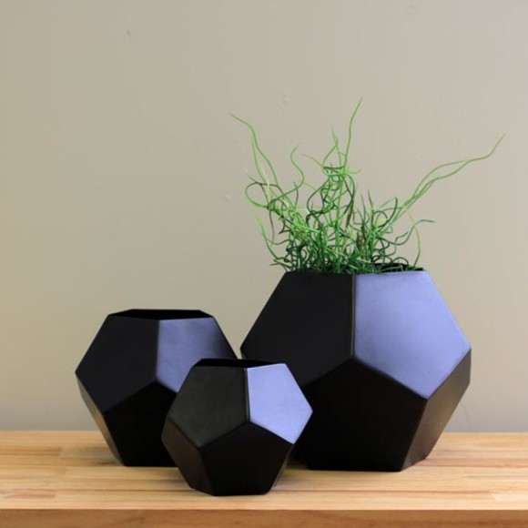 Black vases on a buffet