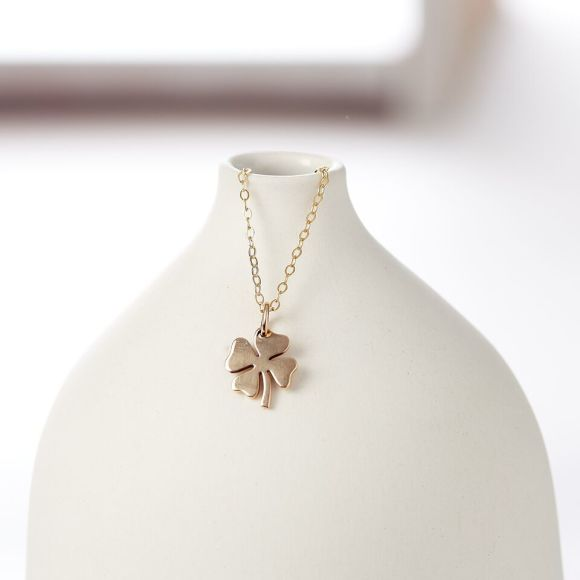 Gold four leaf clover necklace by Suzy Q