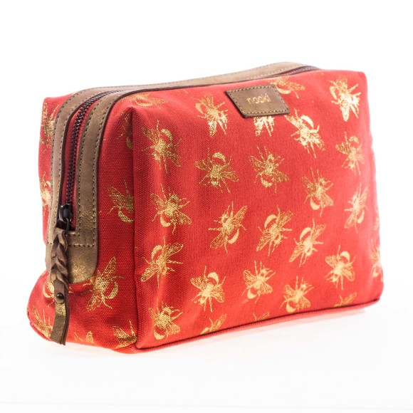 Suki wash bag side shot in coral