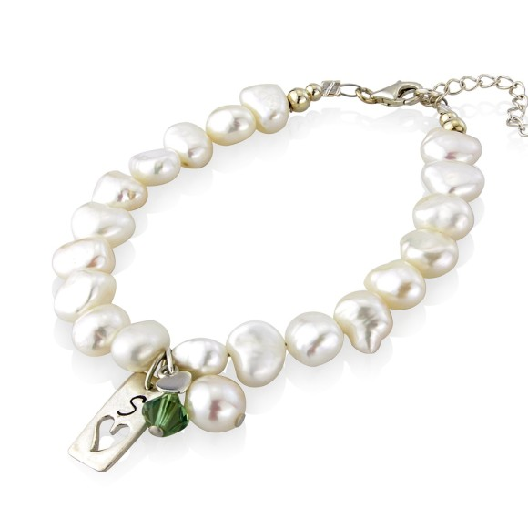personalised pearl bracelet with olive green crystal